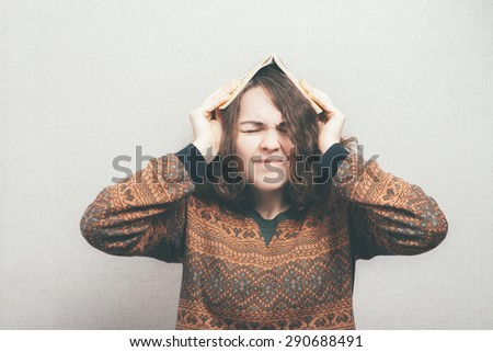 girl with a book on his head - stock photo