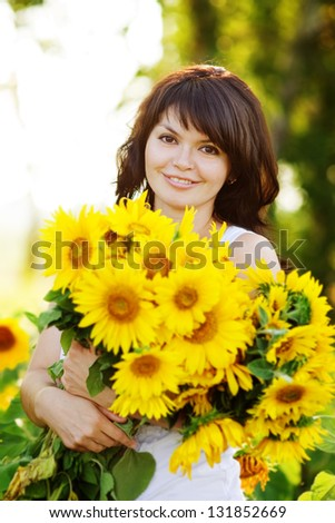 girl with a bouquet of sunflowers - stock photo