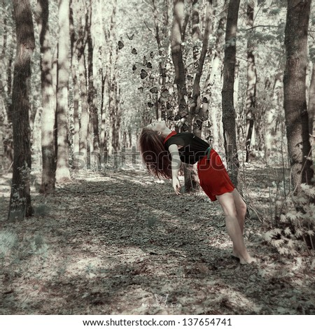 girl with a butterfly fairy-tale forest - stock photo