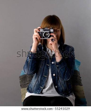 Girl with a camera - stock photo