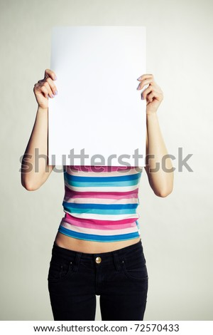 Girl with a clean sheet on a gray background - stock photo