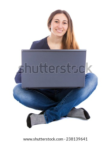 Girl with a computer on a white background - stock photo