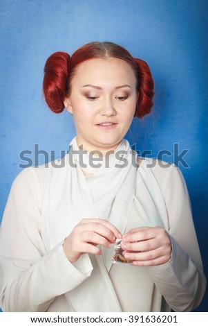 Girl with a condom - stock photo