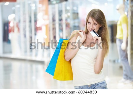Girl with a credit card - stock photo