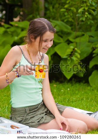 Girl with a cup of tea in garden, emotional - stock photo