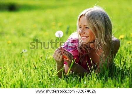 girl with a dandelion in his hand