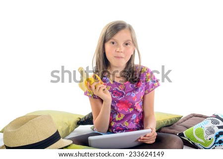 girl with a digital tablet and banana in his hand
