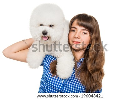 Girl with a dog breed bichon - stock photo