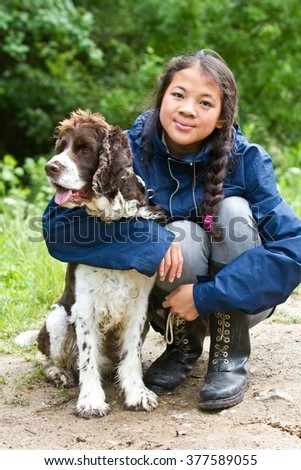 Girl with a dog in denmark in the summer - stock photo