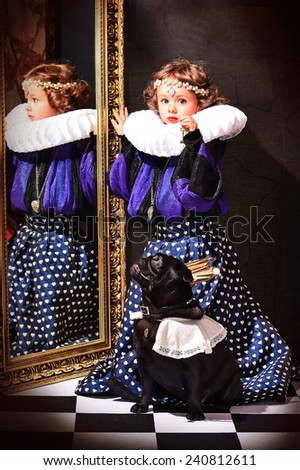 girl with a dog near the mirror, holding a  key - stock photo