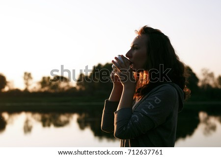 Girl with a drink in autumn