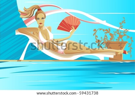 Girl with a Fan lies on a couch near the water on a hot day - stock photo