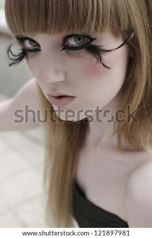 girl with a feather lashes in  make up beauty portrait - stock photo