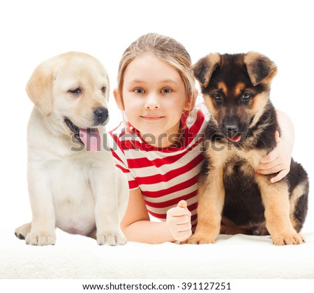 girl with a German Shepherd and Labrador puppy - stock photo