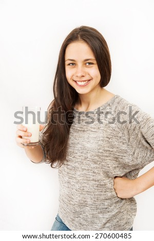 Girl with a glass of milk - stock photo