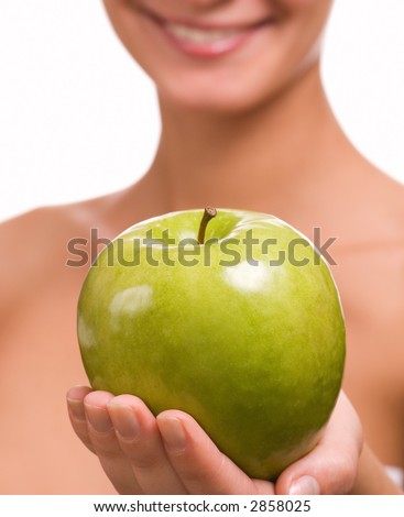 Girl with a green juicy apple - stock photo