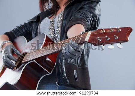girl with a guitar plays rock music - stock photo