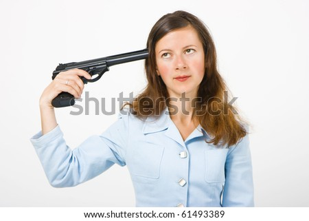 girl with a gun to his temple on a white background
