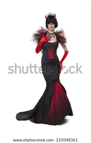 Girl with a Halloween carnival party costume in devil red and black, on white background - stock photo
