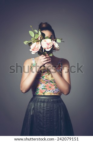 Girl with a head-bouquet of flowers - stock photo