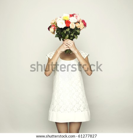 Girl with a head-bouquet of roses. Surreal portrait - stock photo