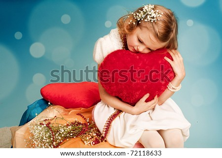 girl with a heart pillow - stock photo