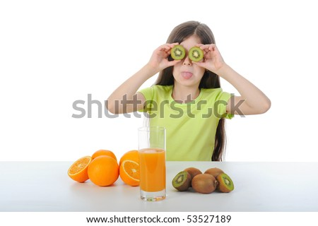 Girl with a kiwi at the table. Isolated on white background - stock photo