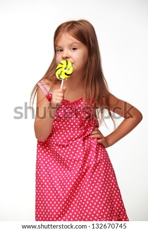 Girl with a lollipop on Food and Drink