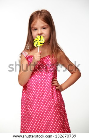 Girl with a lollipop on white background