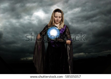 girl with a magic talisman in her hands - stock photo