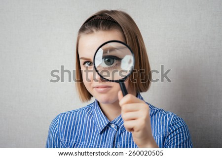 girl with a magnifying glass - stock photo