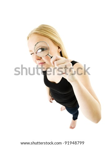 Girl with a Magnifying Glass in front of her eye - stock photo