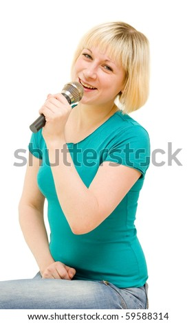 Girl with a microphone on a white background - stock photo