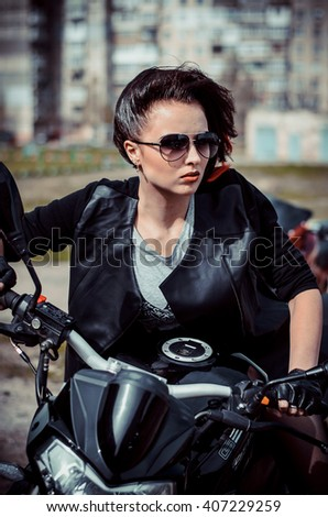Girl with a motorcycle