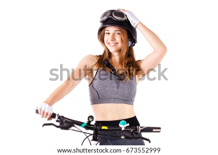 girl with a mountainbike wearing an us army style aviation helmet