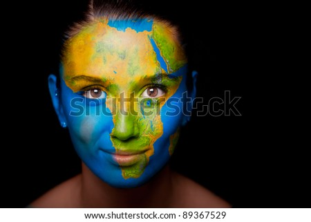 Girl with a painted map of Africa on his face. Closeup. - stock photo