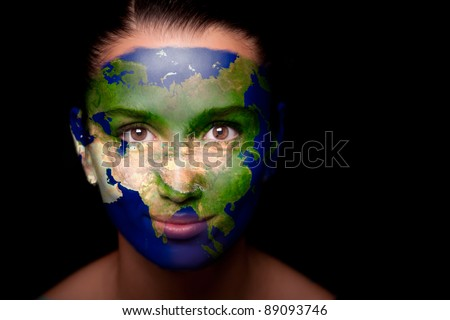 Girl with a painted map of Asia on his face. Closeup. - stock photo