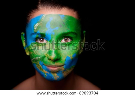 Girl with a painted map of Europe on his face. Closeup. - stock photo
