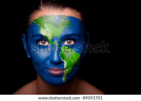 Girl with a painted map of North and South America in the face. - stock photo