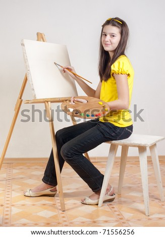 Girl with a palette of paints for the easel