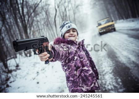 Girl with a Pistol. - stock photo