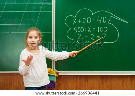 girl with a pointer in the classroom - stock photo