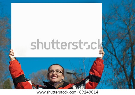 girl with a poster in the sky - stock photo