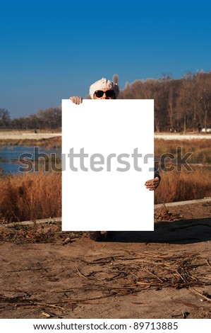 girl with a poster on the nature - stock photo