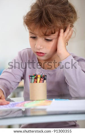 Girl with a pot of crayons - stock photo