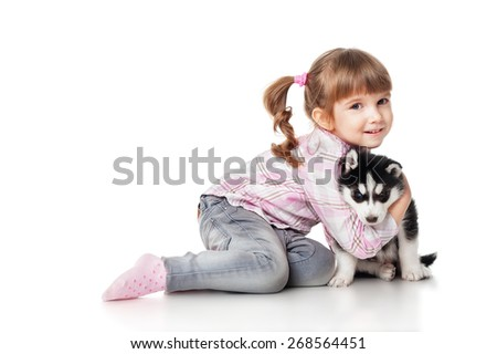 Girl with a puppy husky, isolated on white - stock photo
