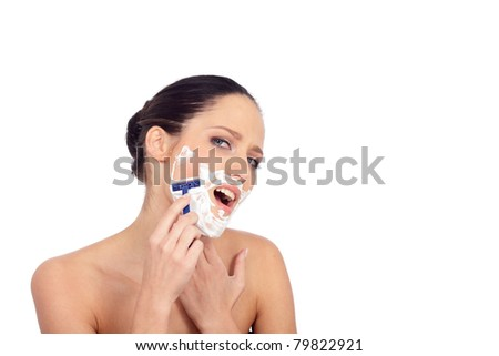 girl with a razor/shaving girl on a white background - stock photo