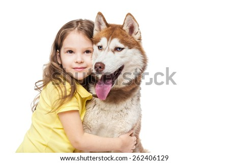 Girl with a redhead husky - stock photo