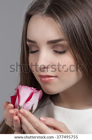 Girl with a rose - stock photo