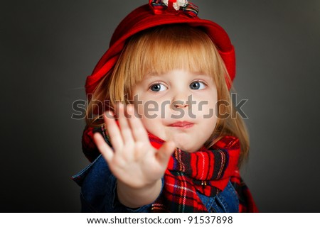 girl with a scarf and hat - stock photo